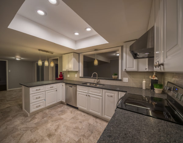 Complete-Modern-Kitchen-Redesign-White-Painted-Cabinets-Dark-Granite-Countertop