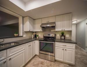 Complete-Modern-Kitchen-Redesign-Stainless-Appliances-custom-range-hood