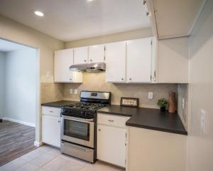 Kitchen-Update-Painted-Cabinets-Stainless-Appliances-Tile-Backsplash