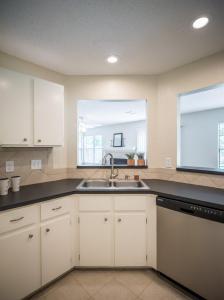 Kitchen-Update-Stainless-Aplliances-White-Painted-Cabinets-Tile-Backsplash-Undercabinet-lighting